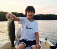 Jaden_with_a_nice_largemouth_bass_taken_off_Dads_boat.jpg